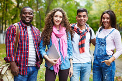 Row of college friends Royalty Free Stock Image