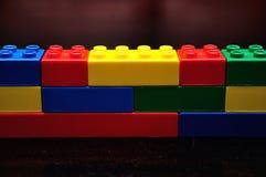 Row of color building blocks built as a wall. A row of color building blocks built as a wall stock photos