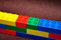 Row of color building blocks built as a wall. A row of color building blocks built as a wall stock photography