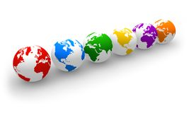 Row of color globes. Globalization concept: row of color globes on white surface Stock Images