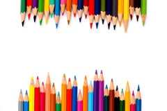 Row of color pencil placed on white background Royalty Free Stock Photo
