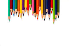 Row of color pencil placed on white background Royalty Free Stock Photos