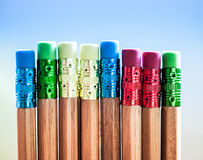 Row of color pencils on blue  background.Studio Royalty Free Stock Photos