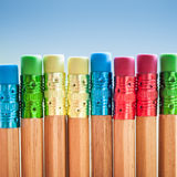 Row of color pencils on blue  background.Studio Stock Images
