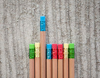 Row of color pencils on grey  background.Studio Royalty Free Stock Photography