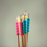 Row of color pencils on grey  background.Studio Stock Photos