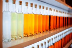 A row of colored bottles with cognac. Tasting Hennessy, Remy Martin stock photos
