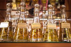 A row of colored bottles with perfume stock photo