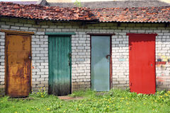 Row of colored doors - red, yellow, blue, green Stock Photos