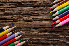 Row of colored drawing pencils closeup on old grunge natural woo Royalty Free Stock Photography