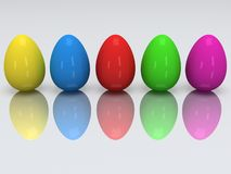 Row of colored eggs. 3D. Stock Photos