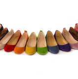 Row of colored  leather shoes. Stock Photo