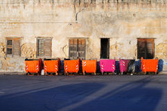 Row of colored rubbish bins Royalty Free Stock Photos