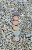 Row of colored smooth stones polished by Baikal Lake. Focus on first Stock Image