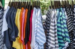 Row of colorful Apparel on Shoulders Hangers of Gondola of Retai Royalty Free Stock Photo