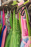 Row of colorful austrain and bavarian dirndl dresses hanging on Royalty Free Stock Photography
