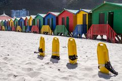 Row of colorful bathing houses at Muizenberg beach stock photos