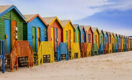 Row of colorful bathing huts in Muizenberg beach, Cape Town, South Africa royalty free stock images