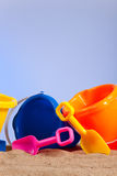 Row of colorful beach buckets or pails Royalty Free Stock Photos