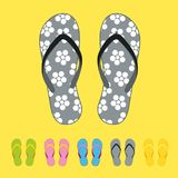 Row of colorful beach flip flops over color background. Beach sandals Stock Photography