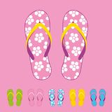 Row of colorful beach flip flops over color background. Beach sandals Royalty Free Stock Photography
