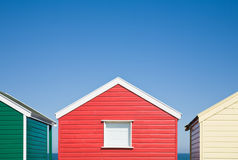Row of colorful beach huts Stock Photos