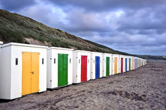 Row of colorful beach huts on empty beach Stock Photo