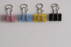 A row of colorful binder clips Stock Image