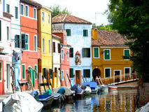 Row of colorful boats and buildings in Burano Venice, Italy Royalty Free Stock Photos