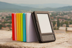 Row of colorful books with e-book reader Stock Photos