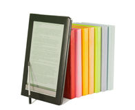 Row of colorful books and electronic book reader Stock Photo