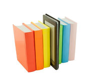Row of colorful books and electronic book reader Royalty Free Stock Image