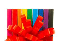 Row of colorful books' spines. Over the white background Royalty Free Stock Images