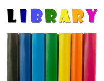 Row of colorful books' spines - Library concept. Row of colorful books' spines over the white background Stock Image