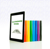 Row of colorful books and tablet PC Stock Image