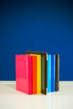 Row of colorful books and tablet PC Royalty Free Stock Photography