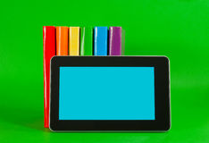 Row of colorful books and tablet PC Stock Photos
