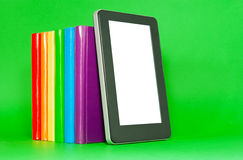 Row of colorful books and tablet PC Stock Images