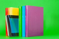 Row of colorful books and tablet PC Royalty Free Stock Photos