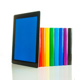 Row of colorful books and tablet PC Stock Photo