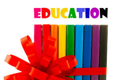 Row of colorful books tied up with ribbon. Education concept Stock Photography