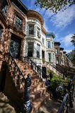 A row of brownstone buildings Stock Images