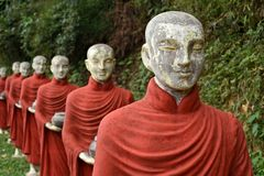 A row of colorful Buddhist monk statues, Hpa-An, Myanmar stock images