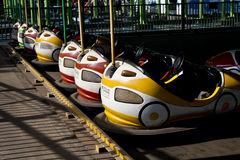 Bumper cars. A row of colorful bumper car Royalty Free Stock Photo