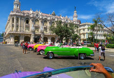 A row of colorful cabriolet retro cars in Havana. Cuba, Havana - 07 April, 2016: beautiful polished colorful brand-new looking American retro cars - Buick and Stock Photography
