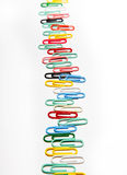 A row of colorful clips. On white Stock Images