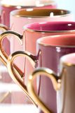 Row of colorful coffee cups. Colorful coffee cups stay in row with all except of one out of focus Royalty Free Stock Photo