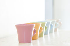 Row of colorful coffee cups Stock Photos
