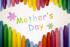 Row of colorful crayon with mothers day message Stock Images