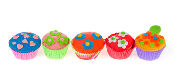 Row colorful cupcakes Royalty Free Stock Photography